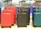 Suitcases, travel bags on wheels, cases with a combination lock in the shopping center ZhongHe Horgos